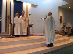 Fr. Henry Petter installed as Monsignor by Bishop Charles Grahmann, assisted by Deacon Jack Guilino, Sunday, May1, 2005