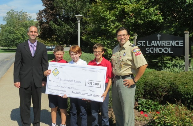 Den leader Patrick McAuliffe,  cub master Ken Haslip, and all of the Boy  Scouts for raising $350.00 for St. Lawrence School through their Adirondack Bench Raffle.