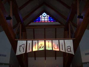 Alleluia banner below stained glass