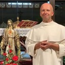 Fr. Dominik invites everyone to participate in the International Mass
