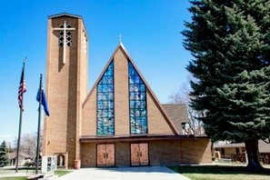 Newly repaired stained glass windows on the front of St. Joseph's Catholic Church