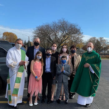 Drive-In Mass participants celebrate First Communion