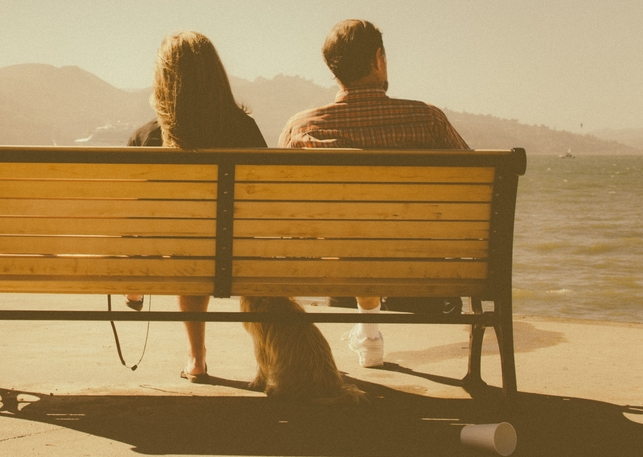 Dating couple on a park bench