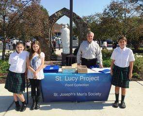 Sixth Grade Volunteers Collect 4.5 Tons of Food For Needy Families