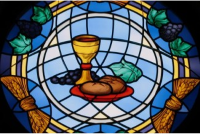 Stained glass window of bread and wine