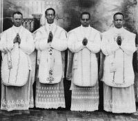 Photo of four black priests at their ordination