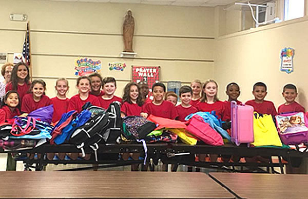 Divine Mercy Academy 3rd graders partnered with St. Monica's Guild to sort and pack all of the school supplies donated by our DMA families for Hurricane Harvey victims. The items were later loaded on a truck to be delivered to Texas.