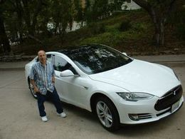 Ron         and Tesla Model S in California