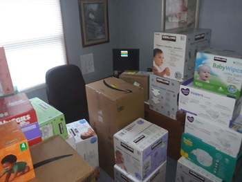 Immaculate Conception and St James Churches donate diapers to Catholic Charities Child Care Centers