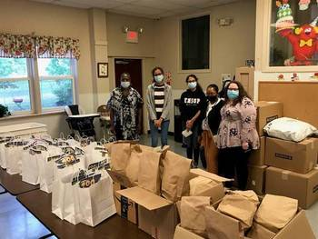 Nandini Patel and Khushbu Mistry delivered care packages to the Ozanam Family Shelter in Edison