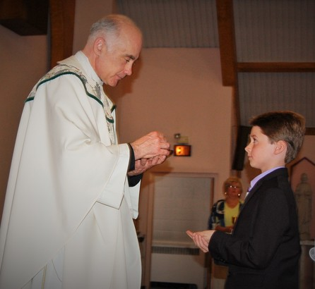 Boy receives First Holy Communion