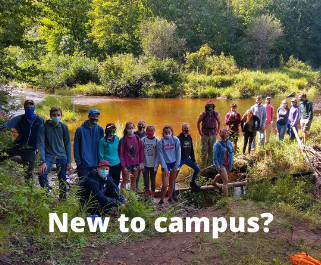 Group of St. Al's students by a river.