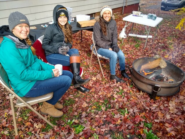 Students outside of a Catholic House during the fall.