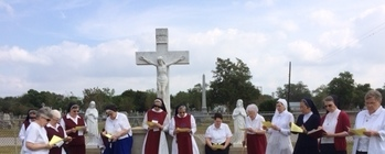 Sisters Pray at Cemetery on All Souls' Day