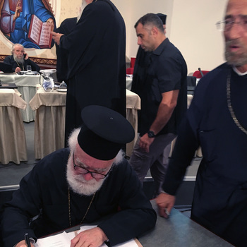 Metropolitan Alexios Signing Official Documents