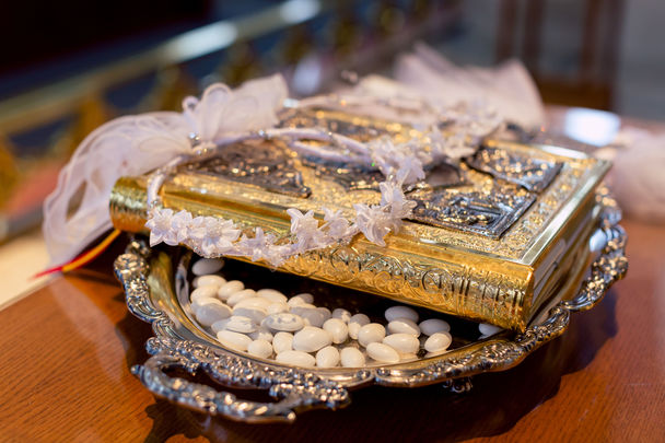 stefana, Gospel and koufeta on a silver tray for a wedding sacrament