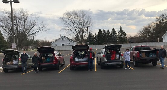 Photo of vehicles loaded with gifts to be delivered
