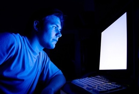 Man in front of a computer screen