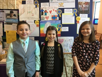 Respect Life Contest winners celebrated at four county Masses