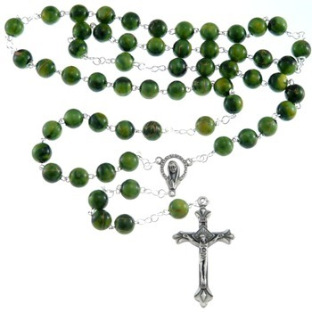 Praying the Rosary before the 8 am, & 11:00 am Masses throughout October.