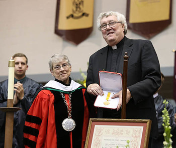 St. Mary's Pastor Bestows Papal Honor on SBU President, Sr. Margaret