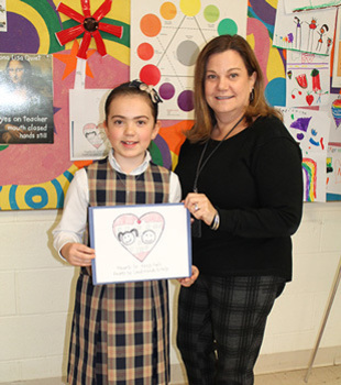 St. Benedict School third-grader designs logo for diocesan Day of Service