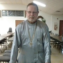 Parish says farewell to longtime pastor, welcomes new young priest