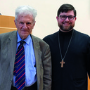 Priest successfully defends doctorate