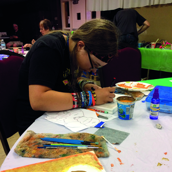 Parishioners paint icons of patron saint