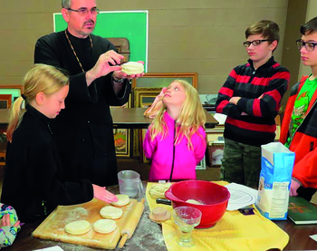 Students learn recipe, theology of Communion bread