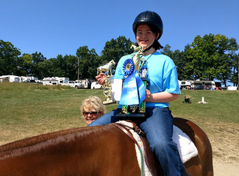 Sacred Heart parishioner takes trophy in equestrian competition
