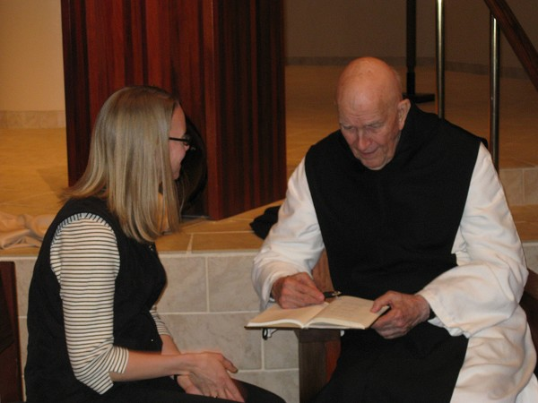Margo visiting with Father Keating last February in St. Paul.