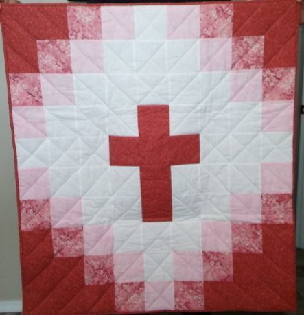 Baptismal quilt with cross at center