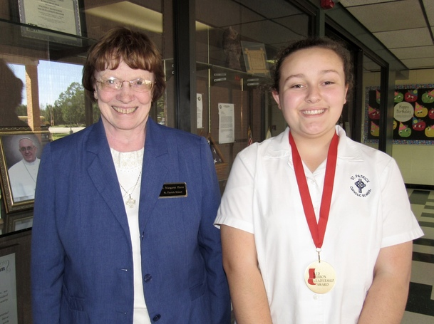 Sr. Margaret Harte, Principal, with Red Ribbon Leadership Award winner, Darby Roberts, 8th grade.