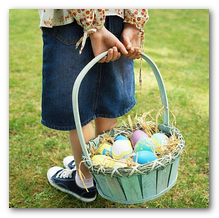 Image of child holding basket of Easter eggs.