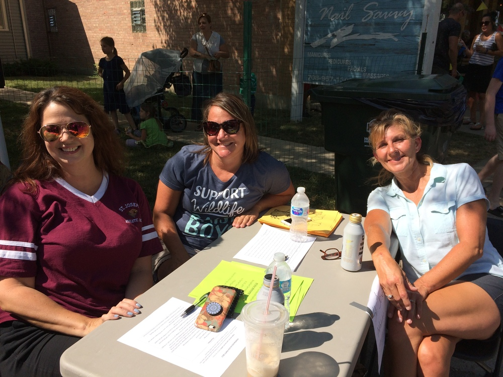 Lisa Purcell, left, and Andrea O'Connor, center, parents of St. Joseph Athletic Association athletes, visit with Penny Milenkoff whose husband is a member of the Knights of Columbus.