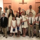 Nine Pinecrest students and an older sibling received their First Holy Communion