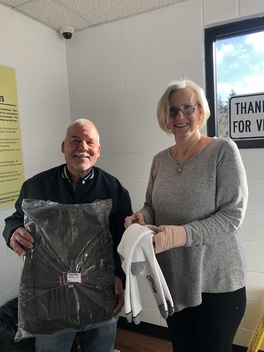 Knights of Columbus donated large, quality backpacks and socks for the men and women at Share the Warmth shelter in Adrian.