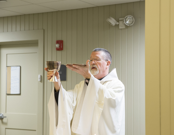 Prior Michael Brunner celebrating House Mass in a dormitory
