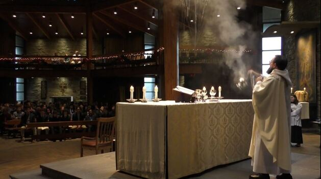 Father Paschal Scotti incenses the altar, Mass during Christmas Season, 2019