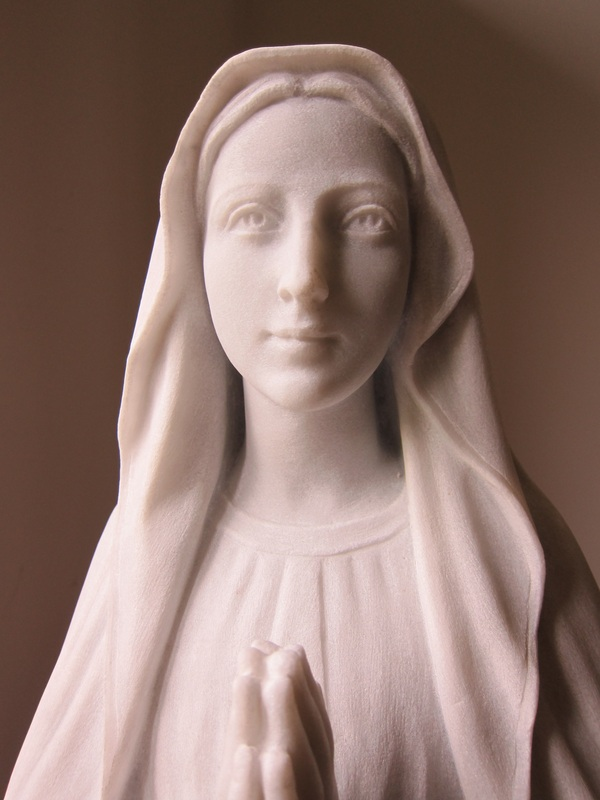 The Immaculate Conception. Hand carved in Italy of pure white Carrara marble in 2012 by sculptor Walter S. Arnold of Chicago, Illinois, now can be seen in the Abbey's Lourdes Grotto on the grounds.