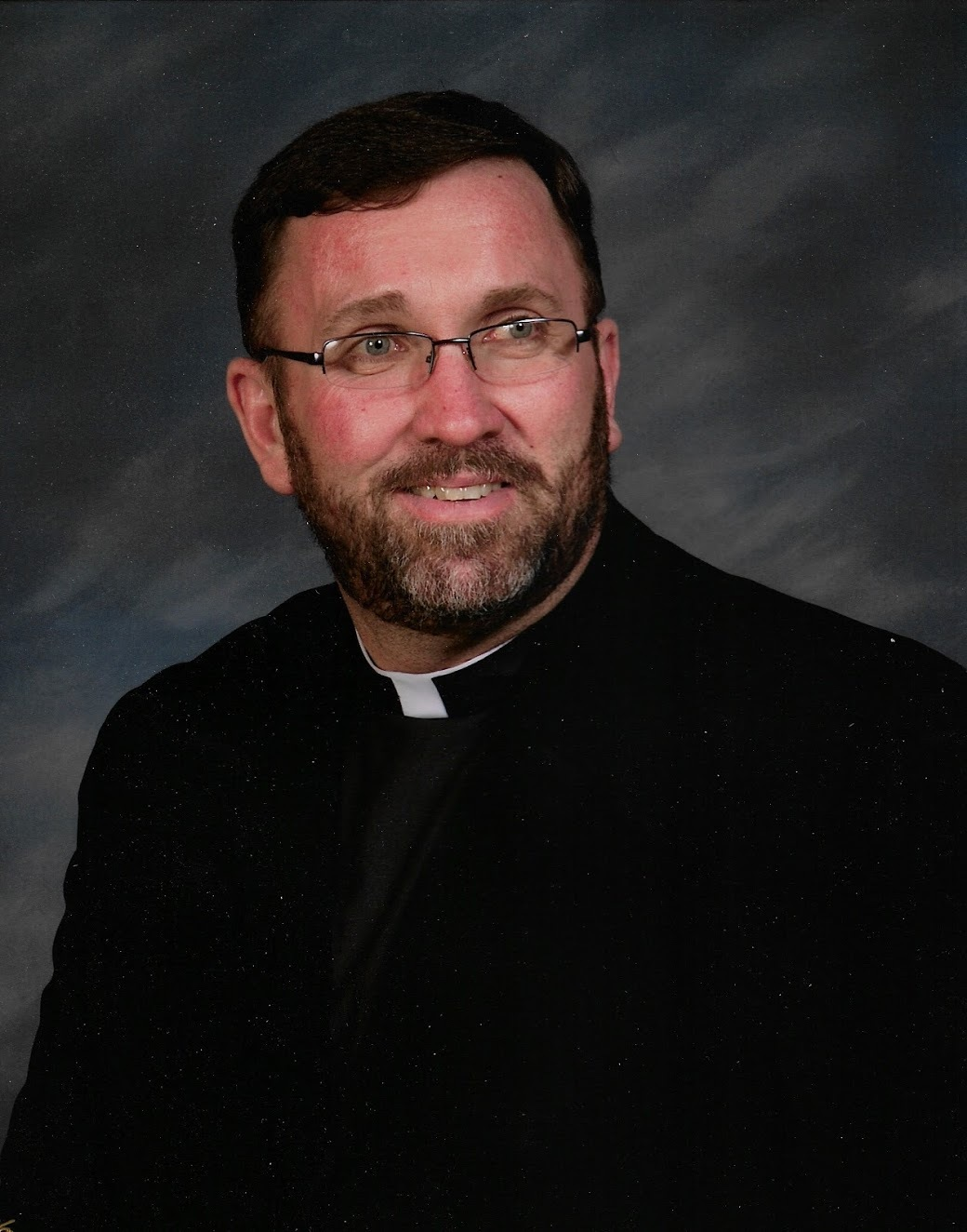 FATHER CHRIS M. WALSH