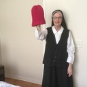 Sr. Joan knits hats for the November Coat Giveaway!