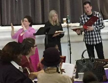 ASL interpreter and two singers at Lesson and Carols event 2016
