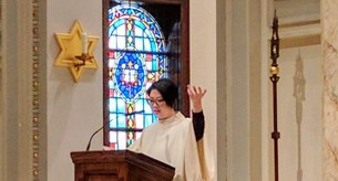 Cantor singing at Mass.
