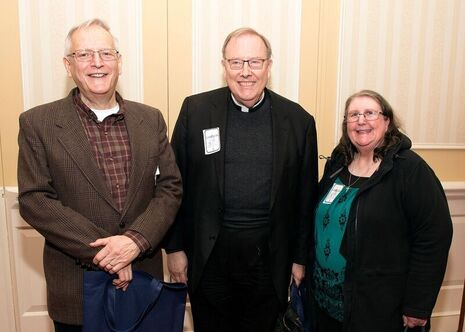 Social Concerns Director Tony Bosnick, Fr. John Dillon and Administrative Assistant Marie Yeast