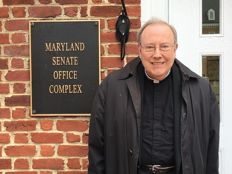 Fr. John standing at the Maryland Senate Office Complex.
