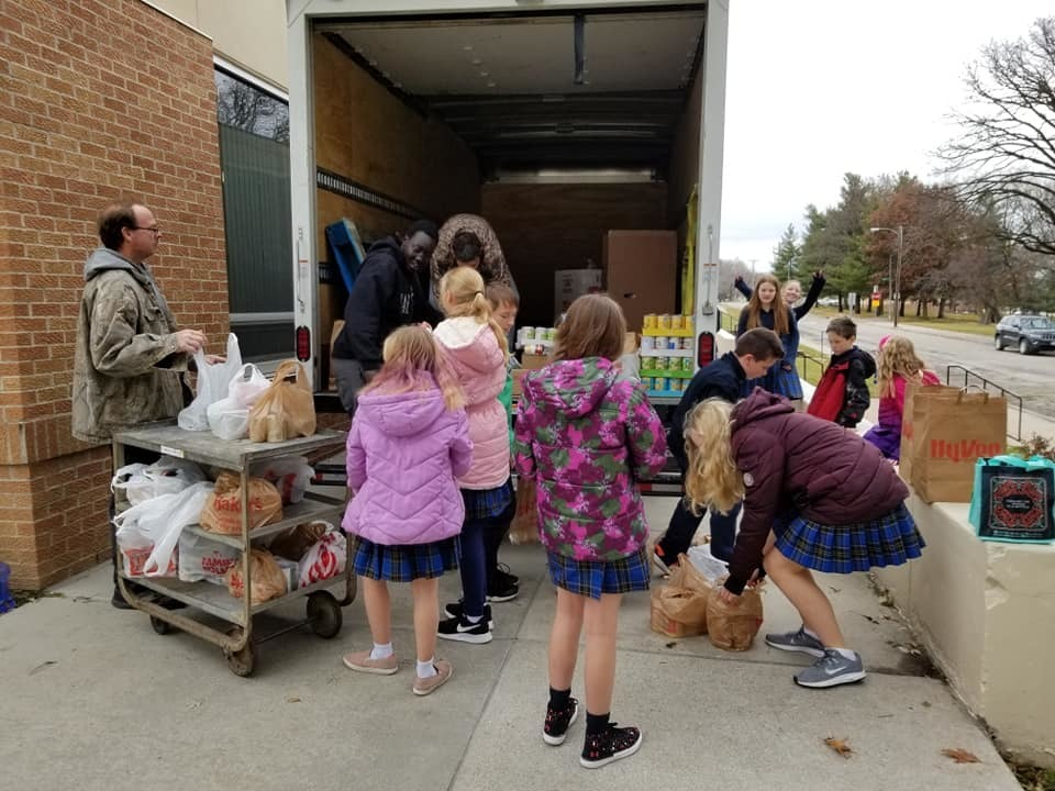 Loading the Canned Goods for the St. Vincent De Paul Food Pantry