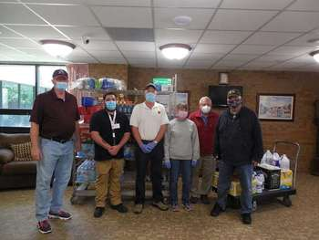 Knights deliver supplies to the Little Sisters of the Poor
