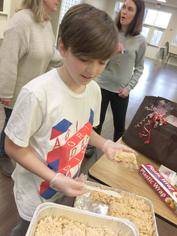 Mercy Serves volunteers making Rice Krispie treats for the patients at NIH Children's Inn